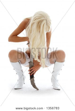 Blond In White Boots And Fishnet Stockings With Big Knife
