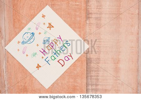 Word happy fathers day and space drawn against view of tissue on desk