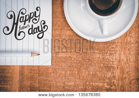 fathers day greeting against above view of a coffee and paper