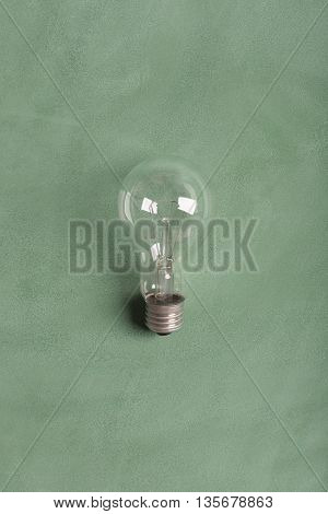 Transparent electric bulb on the green chalkboard (at the center of blackboard)