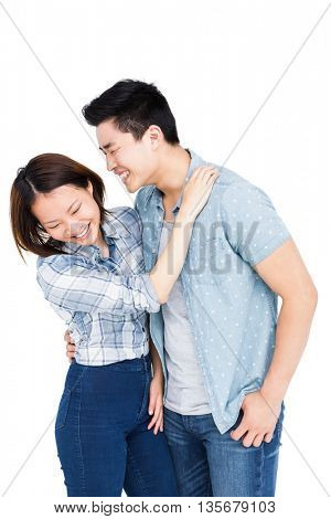 Happy young couple embracing each other on white background