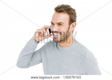 Young man talking on mobile phone on white background