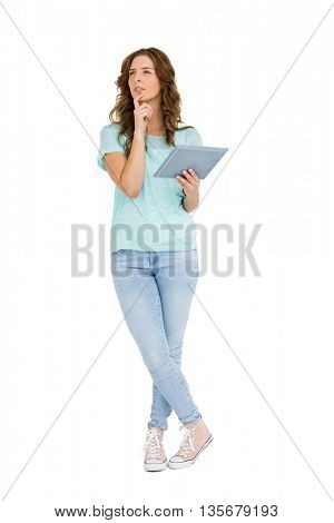 Thoughtful young woman holding digital tablet on white background