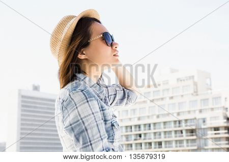 Young woman wearing sunglasses and a hat