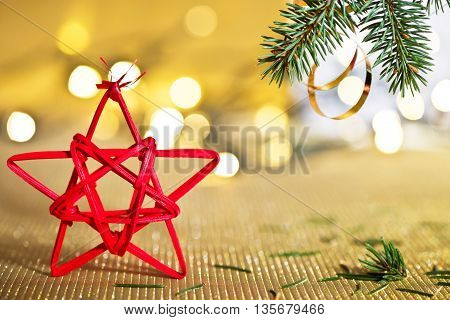 Red Christmas star with needles of Christmas tree