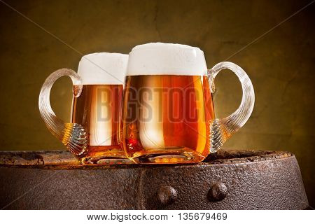two glasses of beer on the old barrel