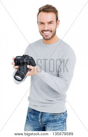 Young man using camera on white background