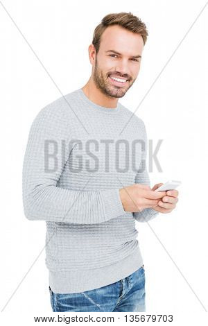 Young man using mobile phone on white background