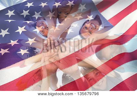 Cropped American flag against children hands stacked