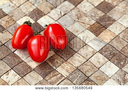 Two Cherry Tomatoes On Wooden Checkered Background, Copyspace