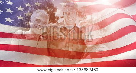 Portrait of army man with parents against digitally generated american flag rippling