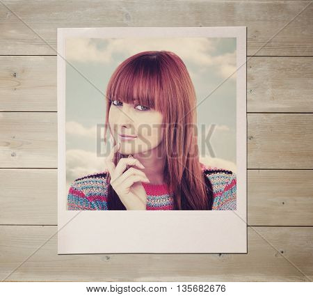 Portrait of a smiling hipster woman against bleached wooden planks background