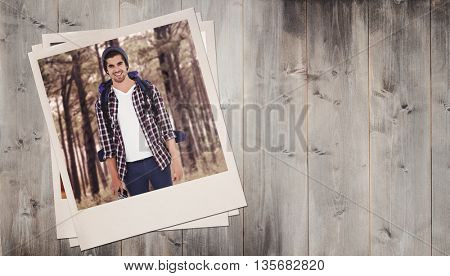 Portrait of happy man standing against wooden planks