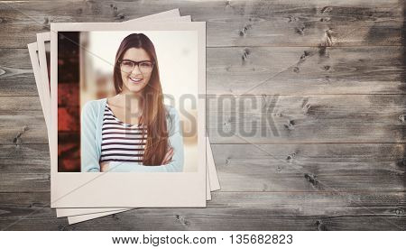 Young creative worker smiling at camera against bleached wooden planks background