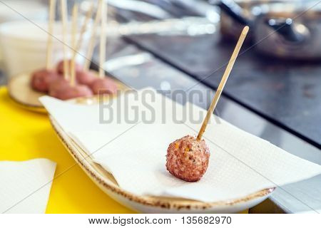 fried meatballs on the stick