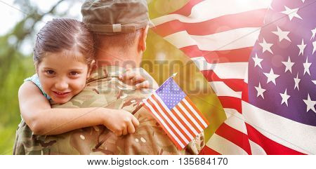 Portrait of girl hugging army officer father against focus on usa flag