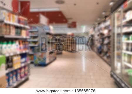 Supermarket with freezer and shelves out of focus nobody.