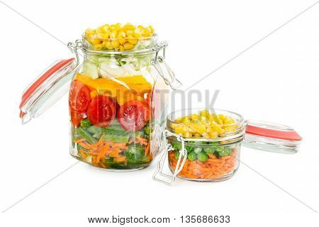 Two Glass Jars With Clips With Colorful Vegetables