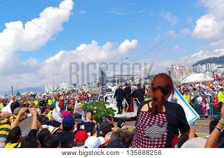 QUITO, ECUADOR - JULY 7, 2015: Pope Francisco mass making a little round trip around the big mass on Ecuador, popemobile.