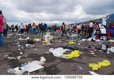 QUITO, ECUADOR - JULY 7, 2015: So terrible photo, garbage on the floor and people passing through and stay around this. Pope Francisco mass event.