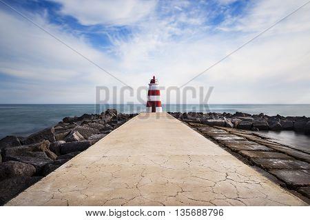 A pier in the Rocha beach in Portimão Algarve Portugal