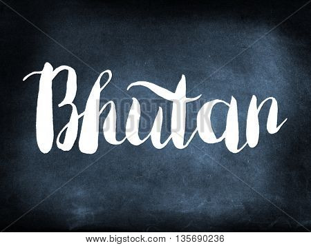 Bhutan written on a blackboard