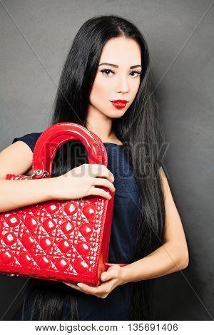 Young beautiful caucasian woman in blue dress