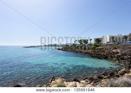 Photo of sea in protaras cyprus island with rocks and hotels.