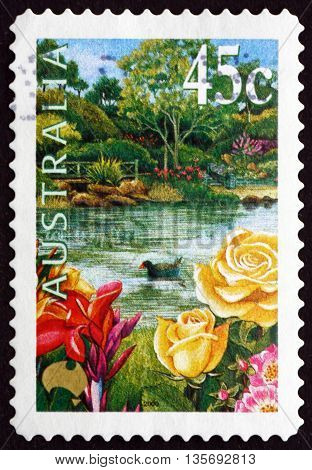AUSTRALIA - CIRCA 2000: a stamp printed in the Australia shows Garden Pond Roses and Purple Swamphen circa 2000