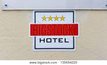 A sign on the wall with the category 4-star hotel