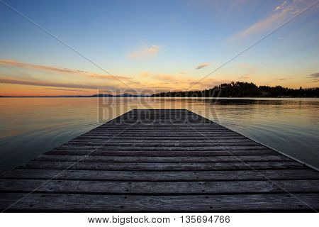 Seascape with lake pier and dramatic sky.