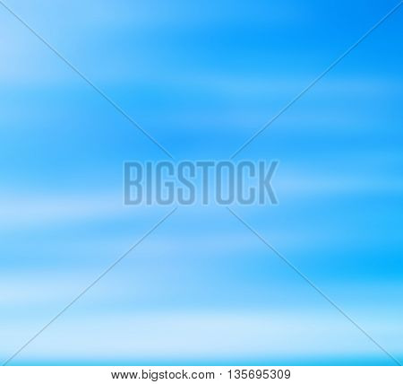 Abstract blurred beach on blue sky background.