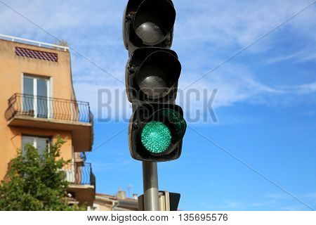 Close Up of Green Illuminated on Traffic Light