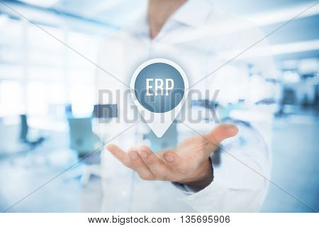 Enterprise resource planning ERP concept. Businessman offer ERP business management software for collect store manage and interpret business data. Double exposed with office in background.