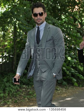 LONDON, UK, JUNE 15, 2015: David Gandy attends the Burberry Prorsum fashion show London Collections picture taken from the street