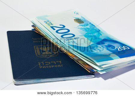 Stack Of Israeli Money Bills Of 200 Shekel And Israeli Passport