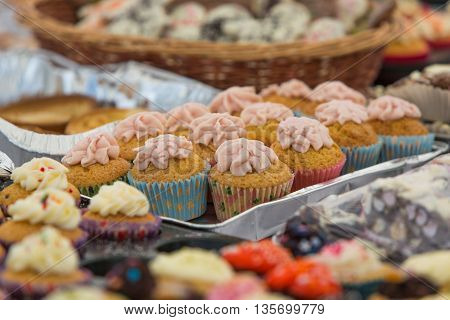 Selection of home made buns, muffins and cup cakes on the food market.