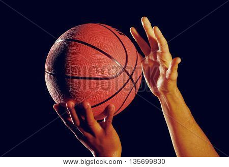 hands with basketball shoot play grip backspin