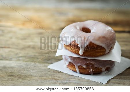 Fresh homemade donuts on a wooden table. Toned image. Selective focus. Copy space for you text
