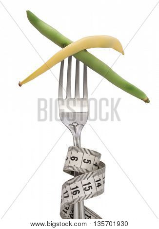 green and yellow beans on the fork, diet concept