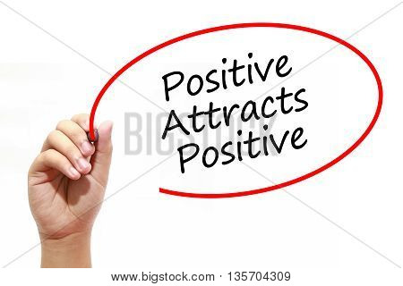 Man Hand writing Positive Attracts Positive with marker on transparent wipe board. Business internet technology concept.
