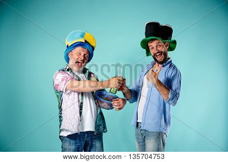 The two football fans over blue background