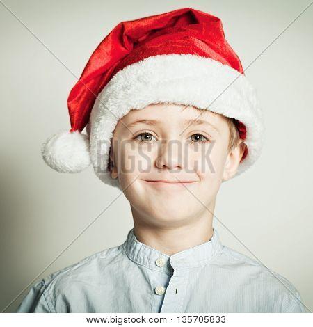 Little boy smyling in Santa Claus hat