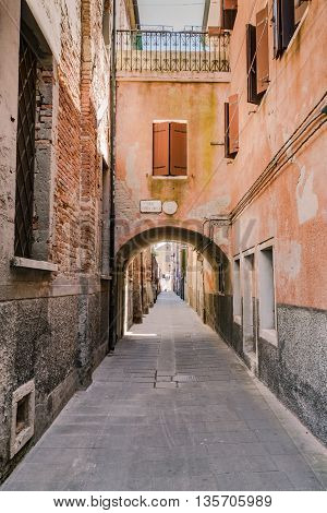 Arched street in the town of Chioggia venice lagoon Italy.