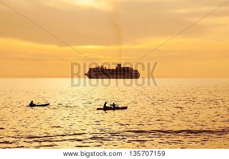 Dramatic sea and transport boat with color of sunset and over light the sun in twilight