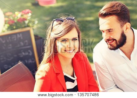 Picture of young couple in restaurant