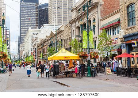 CALGARY, CANADA - JUNE 18: Tourists and Calgarians alike stroll along Stephen Avenue Walk June 18, 2016. The popular and busy pedestrian mall in downtown Calgary is a National Historical District with over 30 restored buildings that feature architectural