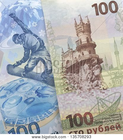 Russian money: 100 rubles Krym and Olympic banknote 100 rubles Sochi 2014 background
