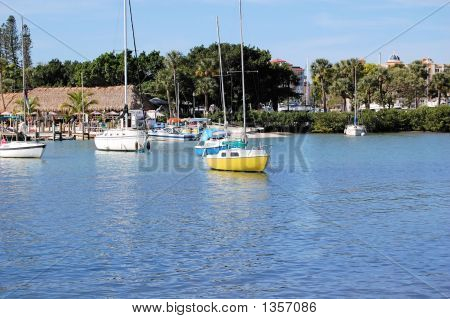 Yellow Sailboat In Harbour