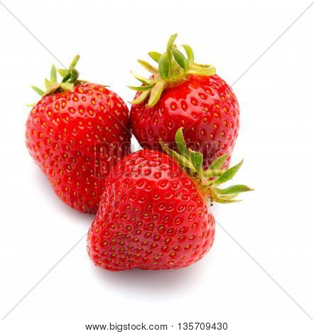 Three fresh, tasty strawberries with leaves, isolated on a white background.
